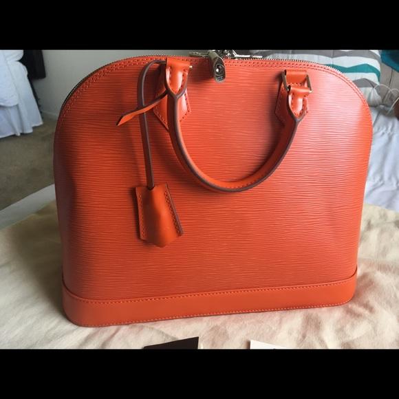 0311a91a02b6 Louis Vuitton Handbags - Authentic LV Alma MM Epi Leather Piment SD1134